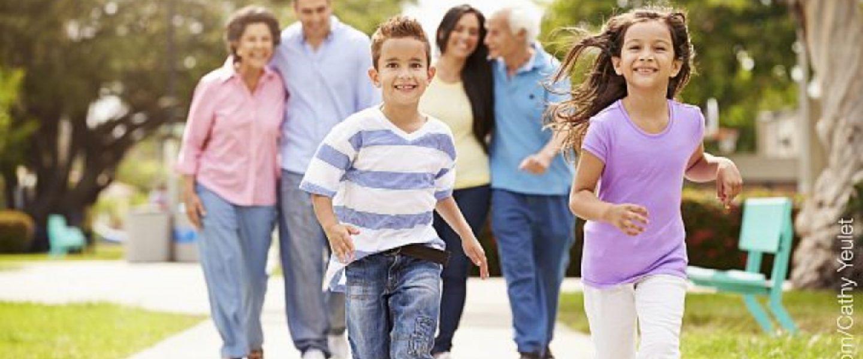 Family in park kids running